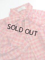レトロカラーラインの柄シャツ